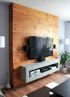 Framing the TV with wood planks.