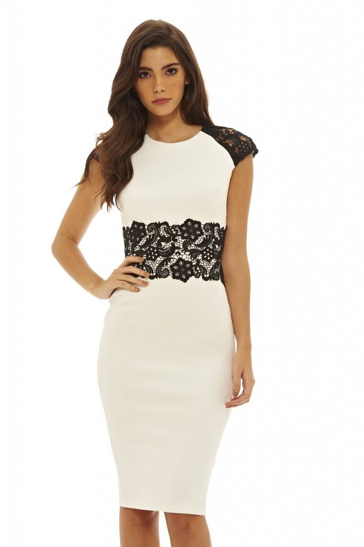 Dostępne różne rozmiary – niezwykle elegancka, biała sukienka z kontrastową koronką – stylowa, czarna koronka zastosowana w okolicach talii podkreśla ją i optycznie wyszczupla – koronkowe rękawki dodają wyrafinowanego i uwodzicielskiego wyrazu – monochromatyczna sukienka o długości midi, pięknie wydłuża sylwetkę – dopasowany fason opina sylwetkę, dodaje seksapilu i bardzo kobiecego wyglądu – sukienka idealna
