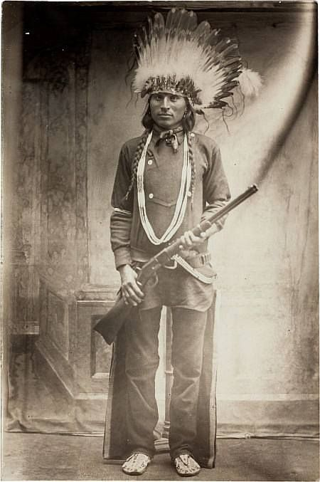 Bad Horse, A Sioux man, holding a Winchester rifle. South Dakota. undated (ca. 1900). keep it real ~ https://tskies.com