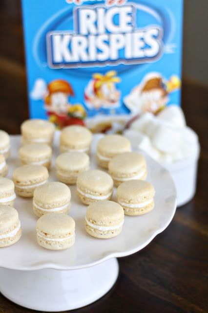 Rice Krispy Treat Macarons. The rice krispy macaron shells were perfectly crispy and chewy and the marshmallow fluff buttercream is seriously heaven, so fluffy and creamy.