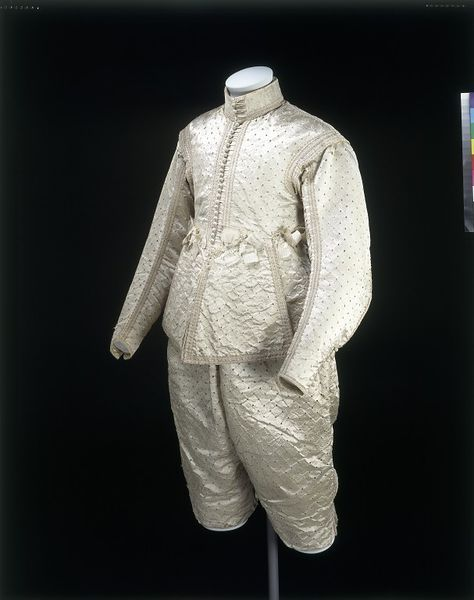 Doublet and breeches, 1630-40, English; Satin, stamped, lined with linen and buckram, trimmed with braid and silk ribbon, hand-sewn
