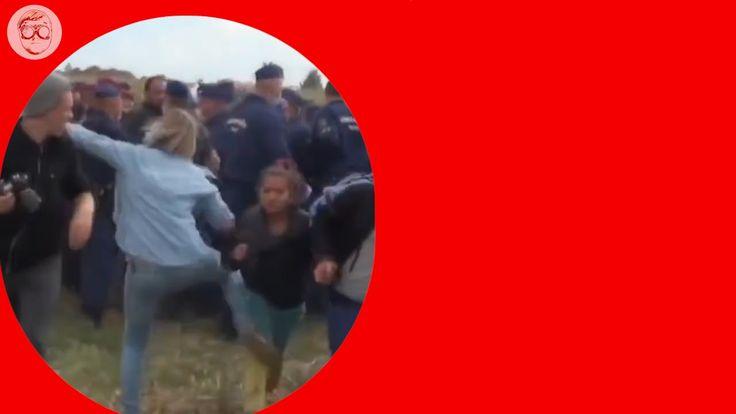Reporter della tv ungherese sgambetta i migranti in fuga - Video Intero