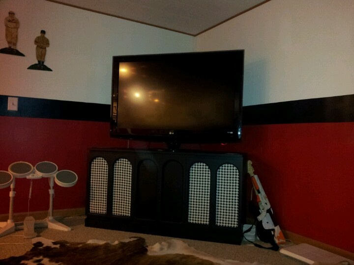 Old record cabinet repurposed as tv console