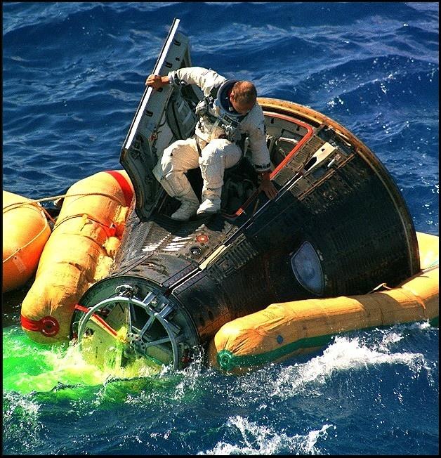 "NASA Astronaut Charles Conrad Jr. emerging from the Gemini 11 space capsule Atlantic Ocean landing September 15, 1966. Gemini 11 was the ninth crewed Earth-orbiting spacecraft of the Gemini series, carrying astronauts Charles ""Pete"" Conrad Jr. and Richard Gordon."