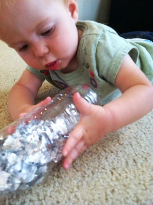 Dozens of ideas for homemade baby toys - she loved this one!
