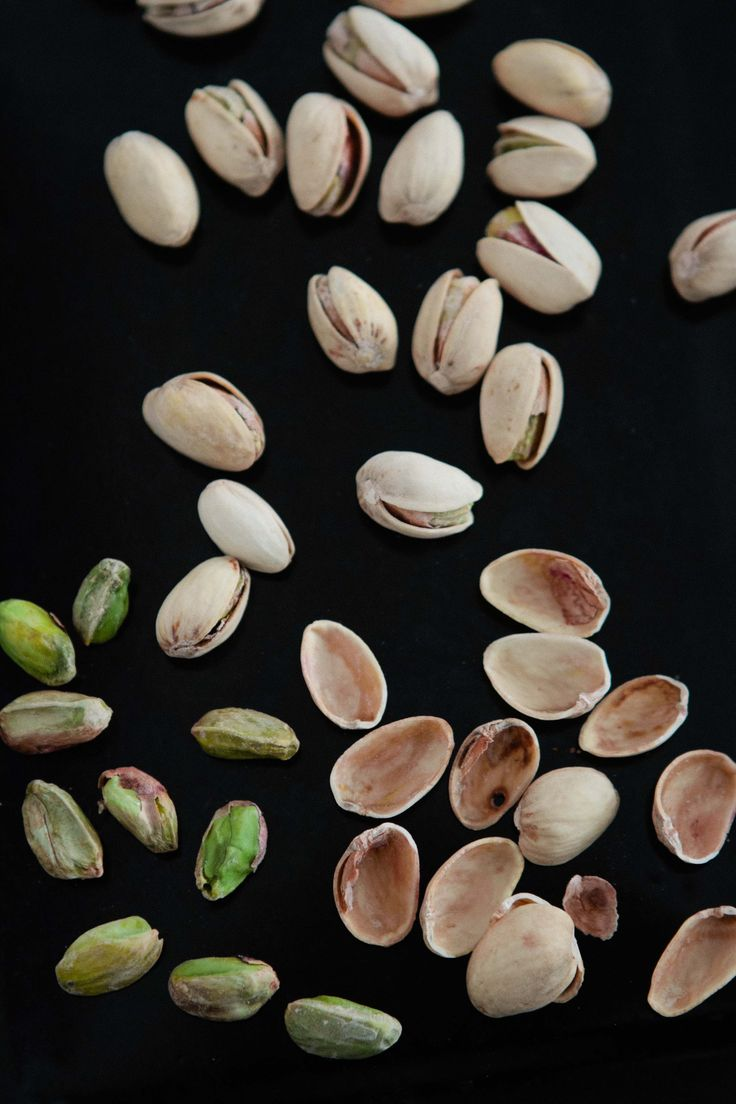 Shelling Pistachio for Cranberry Pistachio Biscotti from A Thought For Food #food