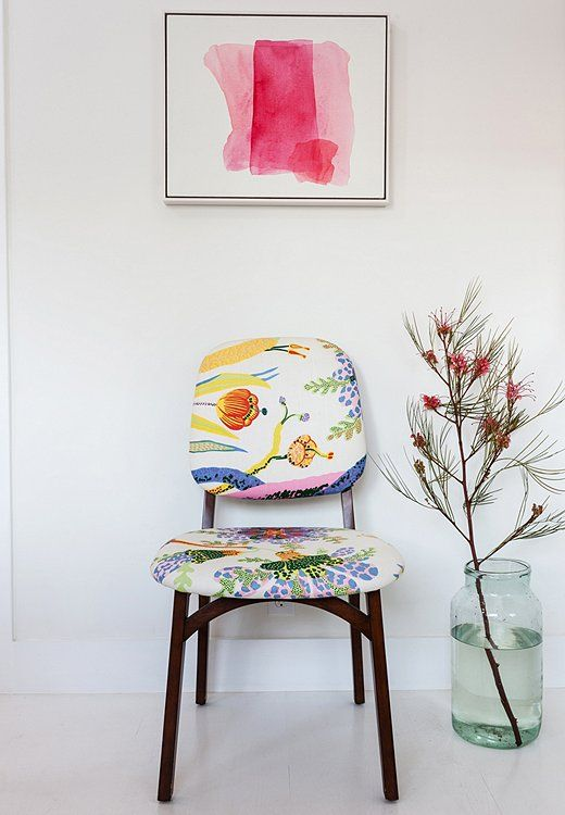 Irene found the set of dining chairs, already upholstered in a vibrant Josef Frank fabric, a decade ago. The pink watercolor is by Mary Weatherford, an L.A. artist known for slashes of neon in her work.