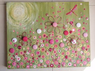 20 x 24 inch mixed media canvas - fabric, fabric covered buttons, wire, glitter glue and buttons.