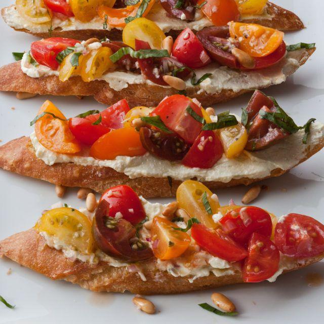 Tomato Crostini with Whipped Feta - feta, cream cheese, olive oil, lemon juice, shallots, garlic, red wine vinegar, heirloom or cherry tomatoes, basil, baguette, pine nuts