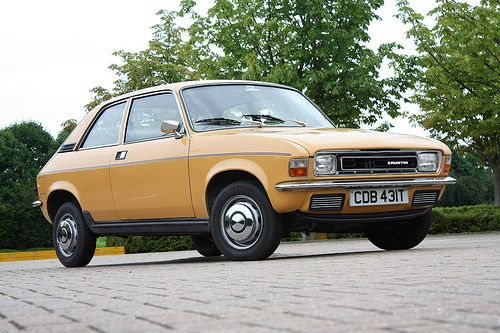 Austin Allegro. Our second car given to us by David. It was this mustardy colour and had mismatched doors and brown fleecy seats.