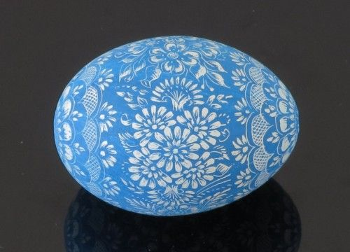 "Opole painted Easter egg, referred to as ""kroszonka"" in Polish, created on basis of blue painted hen eggshell. It is hand decorated with application of method based on hand-engraving of decorating motifs on previously one-coloured eggshell."