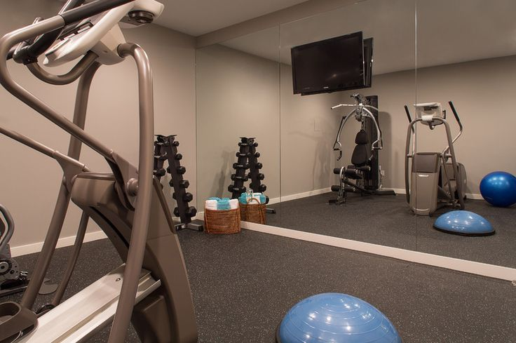 rubberized flooring, space for stretching and yoga, floor-to-ceiling mirrors, a television, gym equipment and storage space