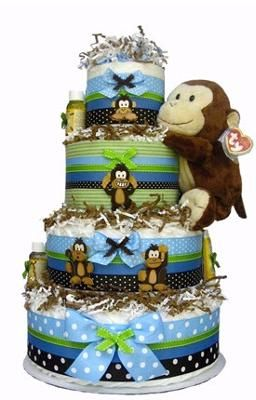 monkey diaper cake: This diaper cake looks pretty high end to me! Not the typical frilly style you see all over the internet, designed by stay at home moms. This one looks