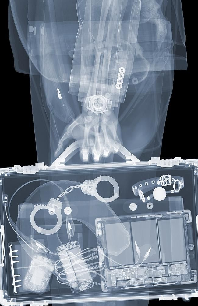 No secrets ... handcuffs and phones can be seen when this briefcase is put through an X-r Nick Veasey
