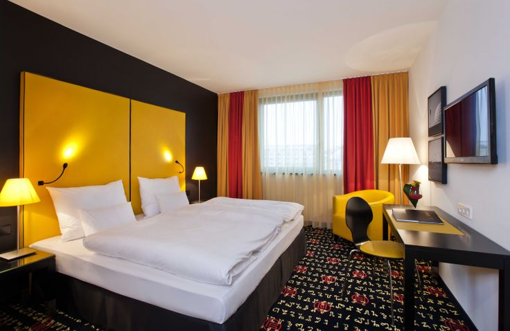 Modern interiors and vibrant #colours await you in the #trendy design rooms at the angelo by Vienna House Munich Westpark. #Munich #Hotel #Businesstrip #bedroom #hotelroom #design