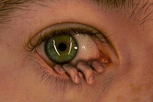 It's hard for me to find the words for a hand hanging on the bottom lid of the eye. Weird, creepy, and interesting just the same. I know there is a story to be had with this. What's yours?