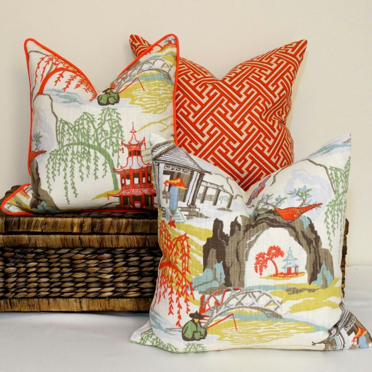 Asian toile cushions with matching coral cross pattern coordinate
