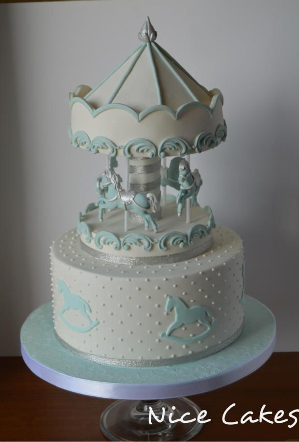 Blue and white carousel cake by Nice Cakes