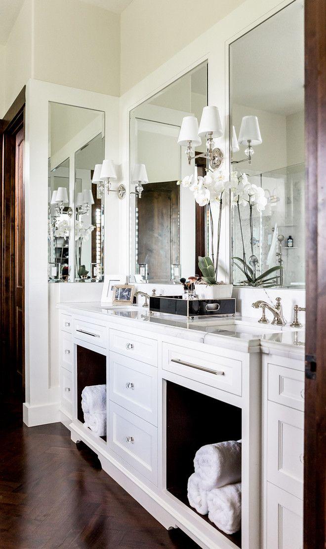 White Dual Bath Vanity with Dark Wood Herringbone Floor: Exquisite master…