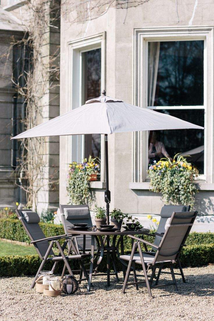A streamlined aluminium set is perfect for sleek summer party style teamed with large glass lanterns for added atmosphere. http://www.woodies.ie