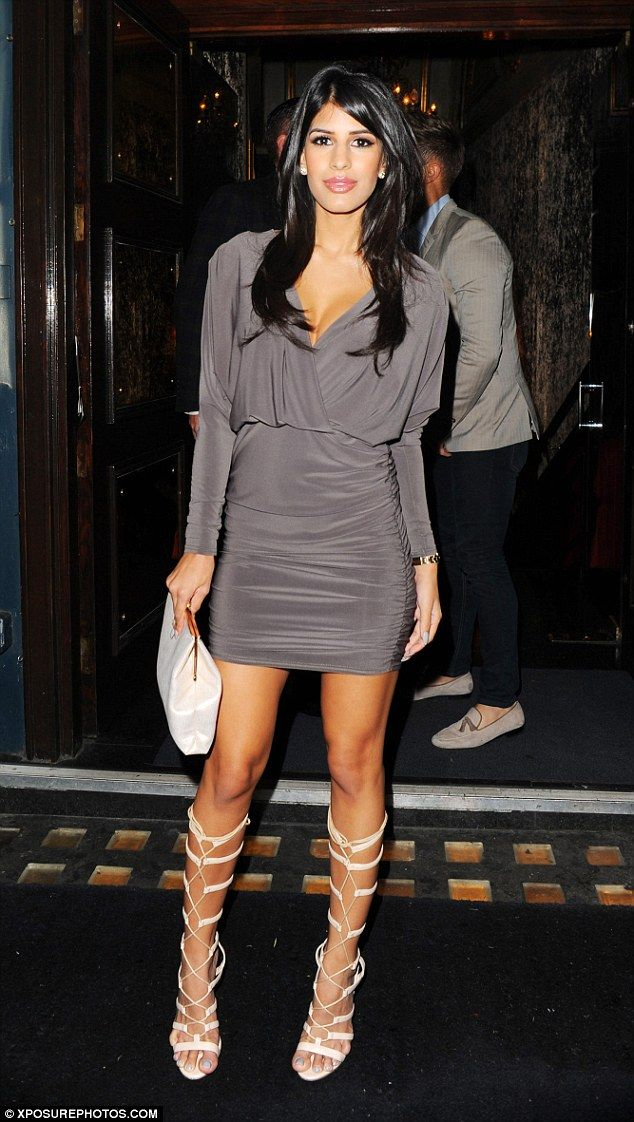 Partying the night away: Jasmin completed her ensemble with a cream clutch bag...
