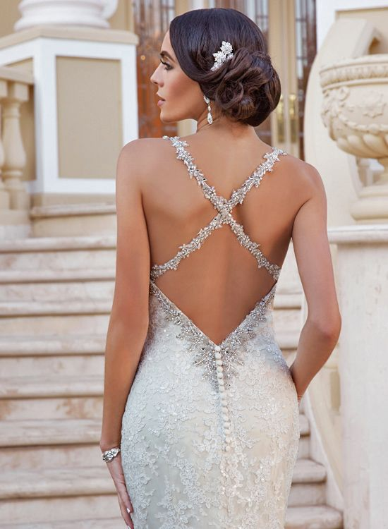 beautiful beaded criss cross straps and deep v back on this wedding gown from