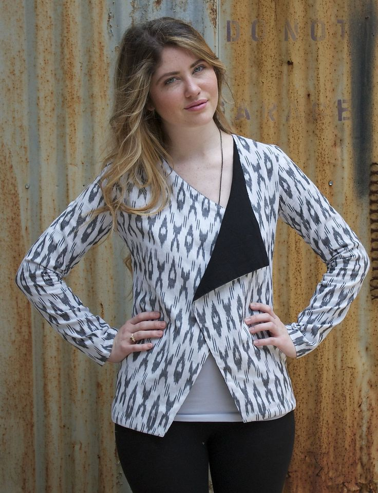 1 Jacket, 3 ways to wear it. This hand woven black and white ikat jacket features a wide open collar, a button closure and gathering in the back for a tailored look. Pair it with our ikat jogger pants or with jeans for a fresh, fun look. Fair trade. Ikat fabric.