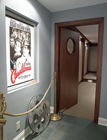Welcome to the movie room. Stanchions, movie reels, posters and portal door all were reclaimed from the local theater that had closed many years ago.