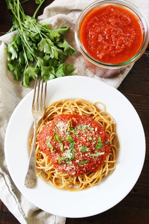 Slow Cooker Marinara Sauce Recipe on twopeasandtheirpod.com This rich and hearty marinara sauce has the BEST flavor because it is made in the slow cooker. You will love this simple sauce!
