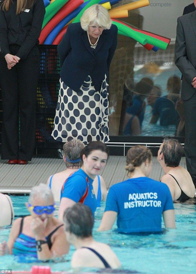 Peering down: The Duchess wore a cream dress with navy blue polka dots and navy blue blazer for the event.   Official Opening of the new Aquatics Center at Aderdeen Sports Village.-- July 9, 2014