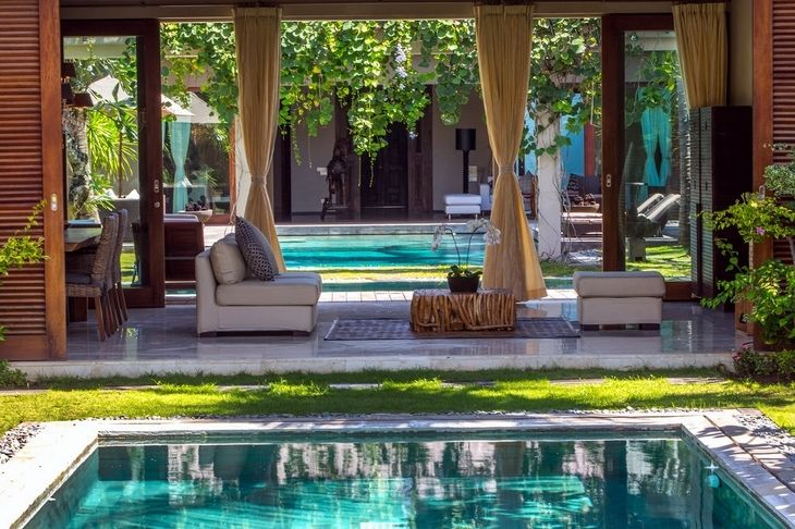 You can always create a pleasant view with a beautiful pool and landscaping