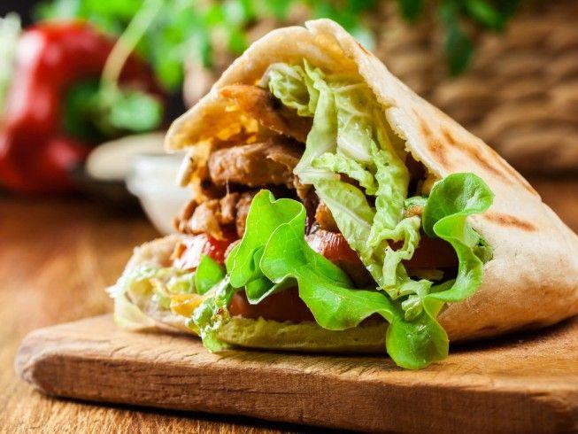 A recipe for Chicago Style Gyros Sandwich made with ground lamb, ground beef, ground pork, lemon juice, garlic, onion, dried oregano, dried