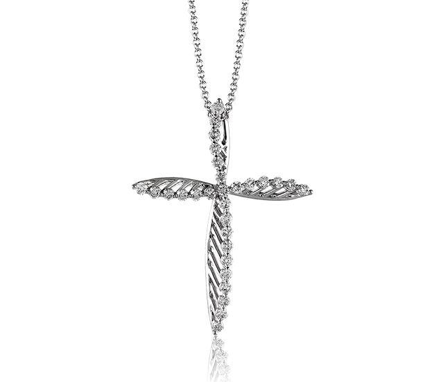 Modern diamond cross in white gold!