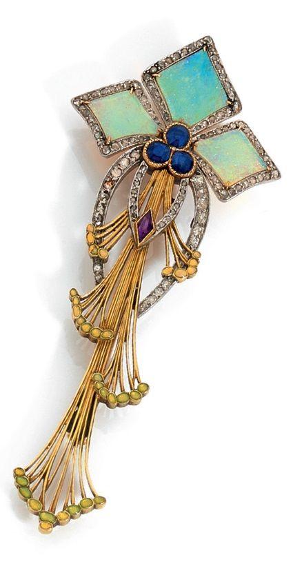 An Art Nouveau 18k gold, enamel, diamond and gem set brooch, circa 1900. Set with opals, diamonds, sapphires and amethyst. Length 7cm.