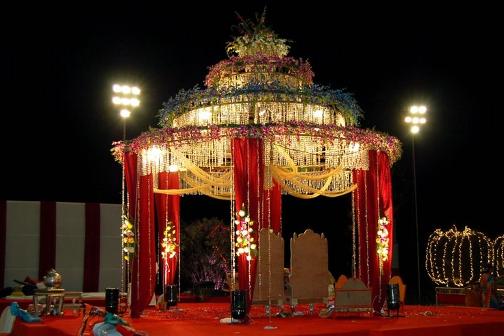 Wedding Mandap with traditional colors and touch of elegance with crystal decor