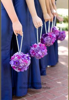 ball of flower arrangements for bridesmaids | The bridesmaids were given charming pomander balls attached to a ...