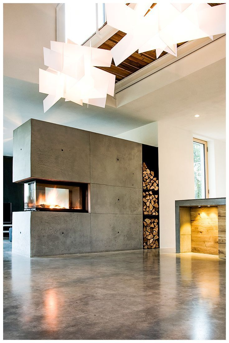 Concrete is modern, but cold – no! Not with a BRUNNER panorama fireplace, built by Rogmans' oven design. Fast and direct heat with a maximum of fire atmosphere. Built here as a unique room divider, for enjoying the fire from all sides for your living room