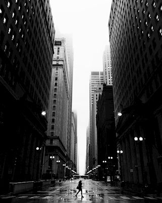 Black and white street photograph of Chicago where the buildings leads you forward. Available as poster at printler.com, the marketplace for photo art. Photographer Susanne Kraft.