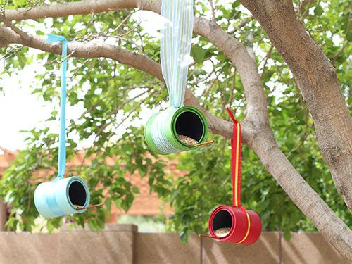 Canned Food Thanks to brightly hued ribbon and unused paint cans (available at home improvement and craft stores), these colorful feeders double as birdhouses. You can also craft them from leftover coffee cans
