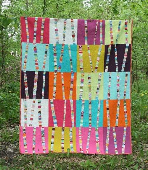 This easy quilt patterns is a perfect scrapbusting project. Strips of scraps are paired with bold solid fabrics to create a stunning quilt. This is a great