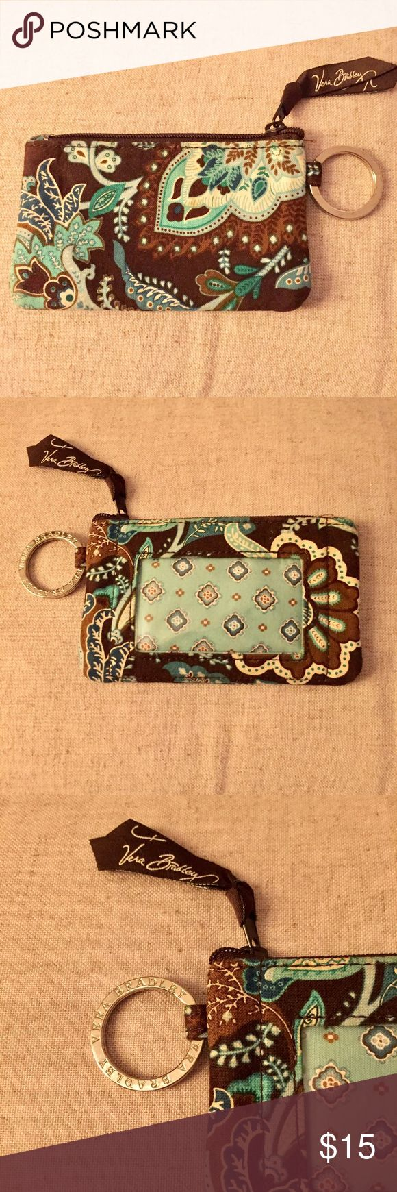 Vera Bradley ID & Coin Holder + Cute and functional!  + Vera Bradley silver ring accent  + Zip closure  + ID window slot  + Font forget to bundle 🛍  ⭐️All items are steamed cleaned and shipped within 48 hours of your purchase. ⭐️If you would like any additional photos or have any questions please let me know. ⭐️Sorry, no trades. But will listen to ALL fair offers. Thanks for shopping! Vera Bradley Bags Wallets