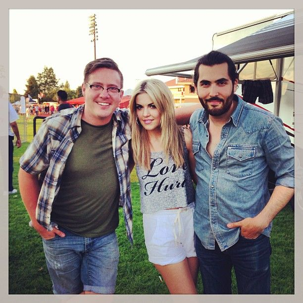 Carly McKillip from One More Girl and band members Jay Tooke and Ariel Posen getting ready to perform at a Canada Day show in Abbotsford, British Columbia, on July 1, 2013