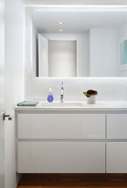 Hexagonal tile backsplash. Backlit mirror. Simple vanity. Clean.
