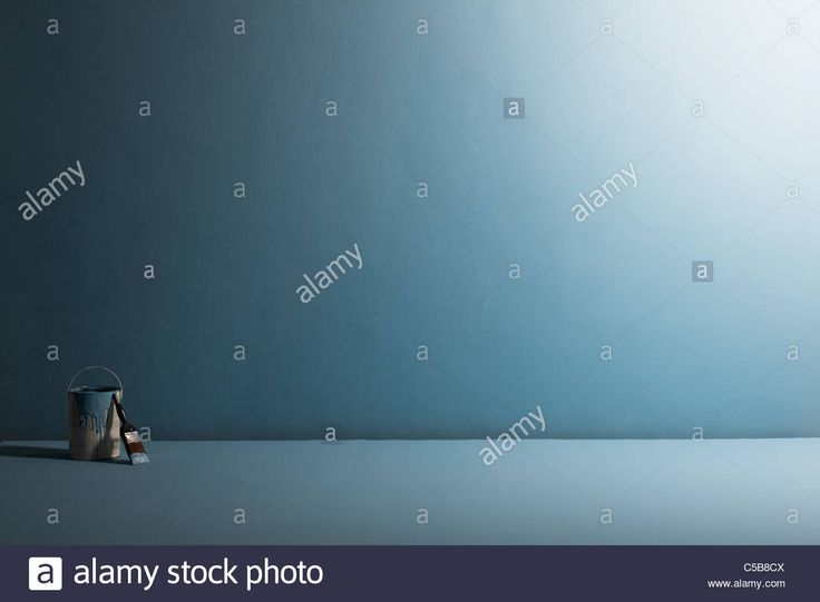 Download this stock image: Paint pot and paintbrush on blue background - C5B8CX from Alamy's library of millions of high resolution stock photos, illustrations and vectors.