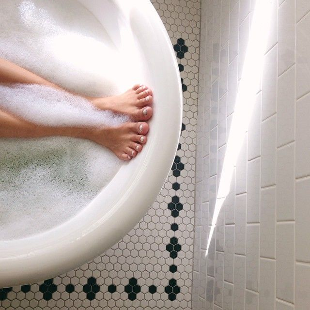 Floor tile boarder meets victorian style white rectangular wall tiles #BathroomInspiration