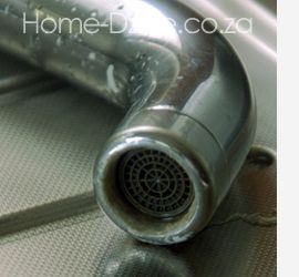 limescale hard water on kitchen mixer tap faucet