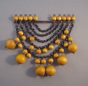 http://www.morninggloryjewelry.com/aarikka-finland-midcentury-modern-brooch-p-12143.html