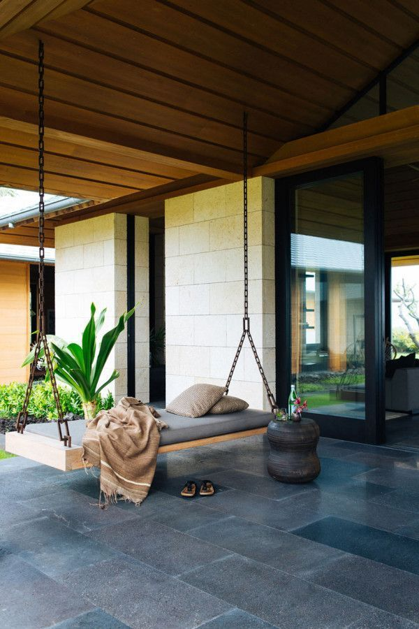 Nicole Hollis designed this contemporary home in Hawaii for a couple who were Southern California natives that fell for the coast of Kona long ago. The home boasts indoor/outdoor living that's complete with a relaxing bench swing to enjoy the Hawaiian breeze. Photo courtesy of Laure Joliet #ad