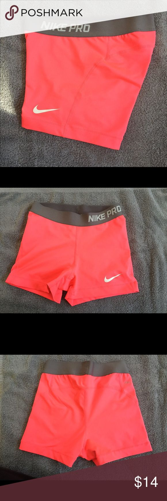 Nike Pro compression short Nike compression short for women, size small, bright coral in color. Lightly worn but in great condition Nike Shorts