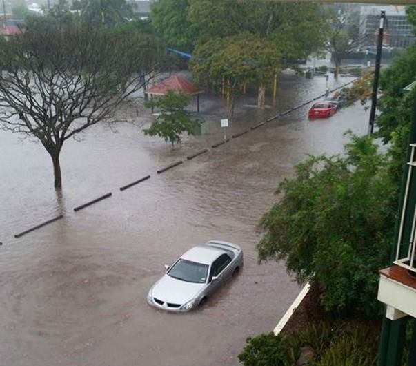 Nov 19,2014: A flooded car in Fisher St, Brisbane. Wild weather caught on camera during ferocious Brisbane storms.